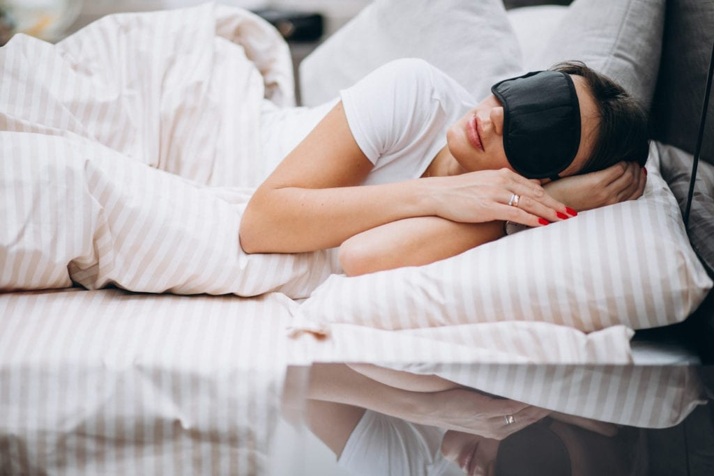 Young woman resting in bed in the morning